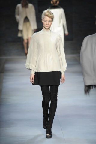 Clothing, Footwear, Leg, Fashion show, Sleeve, Shoulder, Textile, Runway, Joint, Outerwear,