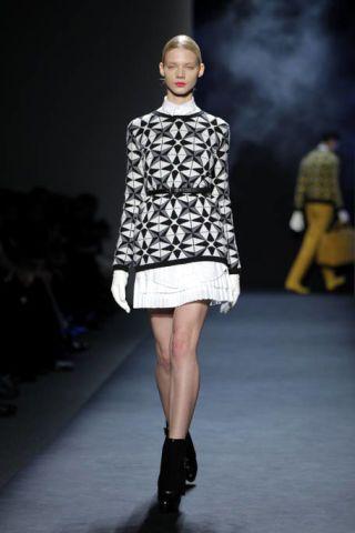 Clothing, Leg, Fashion show, Human leg, Shoulder, Joint, Outerwear, Runway, Fashion model, Style,