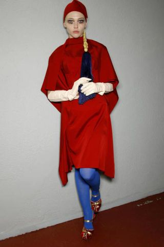 Textile, Red, Standing, Joint, Fictional character, Electric blue, Costume, Costume accessory, Carmine, Wig,