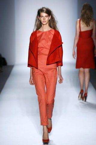 Clothing, Footwear, Leg, Fashion show, Human leg, Shoulder, Red, Joint, Runway, Fashion model,