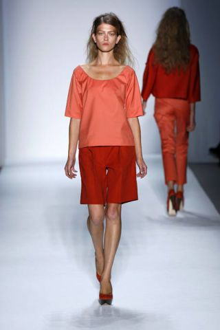 Clothing, Leg, Brown, Sleeve, Fashion show, Human leg, Shoulder, Red, Textile, Joint,