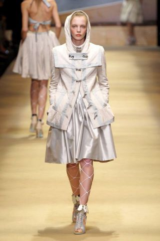 Clothing, Leg, Fashion show, Shoulder, Joint, Outerwear, Runway, Human leg, Fashion model, Style,