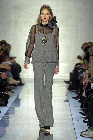 Clothing, Footwear, Leg, Fashion show, Shoulder, Runway, Joint, Outerwear, Style, Fashion model,