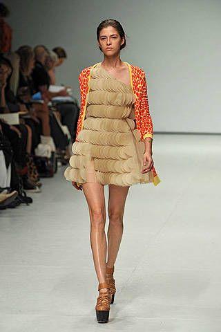 Clothing, Footwear, Leg, Fashion show, Event, Shoulder, Runway, Human leg, Fashion model, Dress,