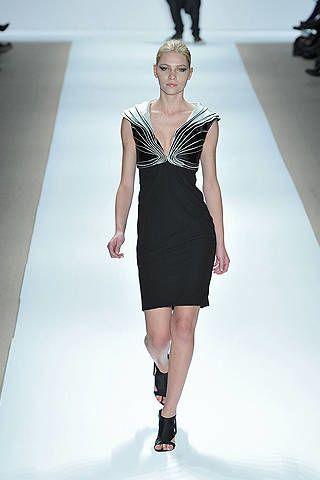 Leg, Hairstyle, Dress, Shoulder, Human leg, Fashion show, Joint, Standing, Fashion model, Formal wear,