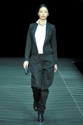 Sleeve, Collar, Joint, Outerwear, Standing, Suit trousers, Formal wear, Fashion show, Style, Coat,