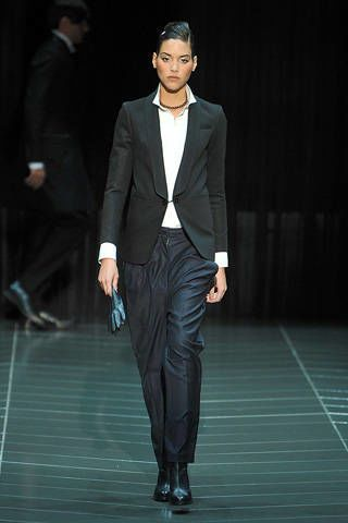 Leg, Sleeve, Human body, Coat, Fashion show, Collar, Joint, Standing, Outerwear, Suit trousers,