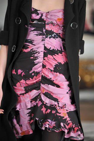 Textile, Pink, Fashion, Black, Waist, Pattern, Embellishment, Peach, Fashion design, Natural material,