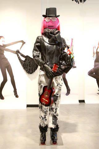 Standing, Costume accessory, Carmine, Fictional character, Costume, Armour, Costume design, Costume hat, Fashion design, Action figure,