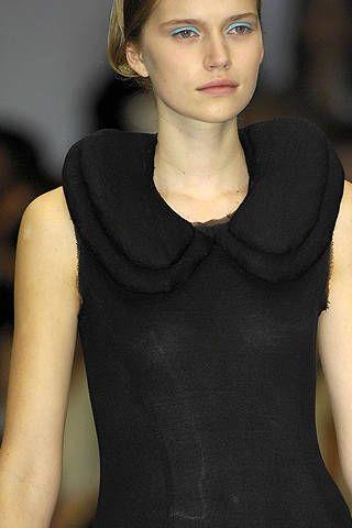 Lip, Neck, Black, Sleeveless shirt, Body jewelry, Portrait, Makeover, Throat, Eye liner, Little black dress,