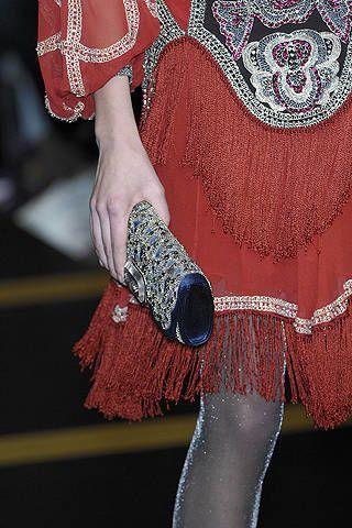 Textile, Pattern, Wrist, Fashion, Maroon, Motif, Visual arts, Tradition, Embellishment, Body jewelry,