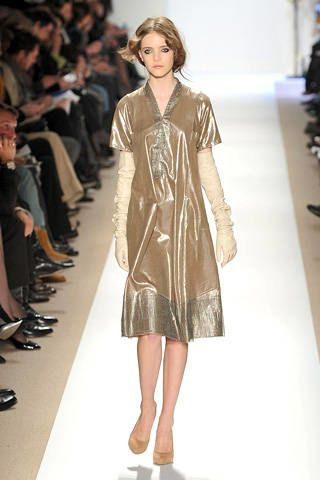 Clothing, Brown, Sleeve, Shoulder, Joint, Human leg, Outerwear, Fashion show, Fashion model, Style,