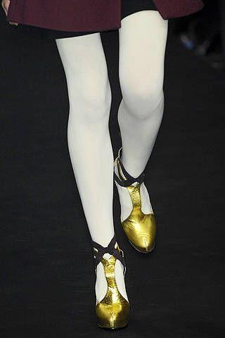 Leg, Yellow, Human leg, Joint, Style, Sandal, Thigh, Fashion, Black, Knee,