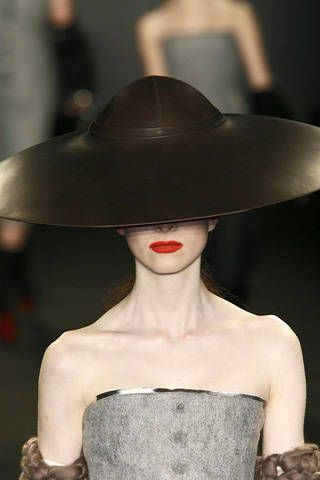 Hat, Lip, Shoulder, Joint, Style, Headgear, Costume accessory, Fashion accessory, Fashion, Black,