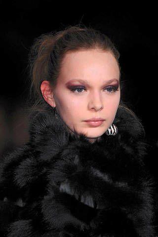 Lip, Cheek, Hairstyle, Eyebrow, Textile, Eyelash, Fur clothing, Style, Iris, Black hair,