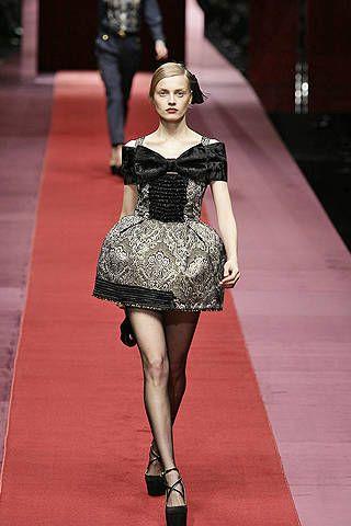 Clothing, Leg, Dress, Human body, Shoulder, Joint, Flooring, Human leg, Style, Formal wear,