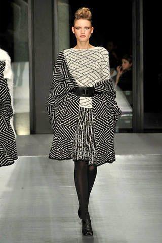 Clothing, Human body, Shoulder, Fashion show, Joint, Dress, Fashion model, Style, Pattern, Runway,