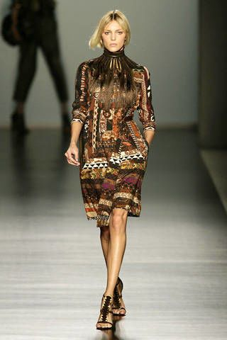 Clothing, Leg, Brown, Shoulder, Human leg, Fashion show, Joint, Fashion model, Style, Runway,