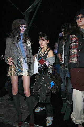 Clothing, Face, Textile, Bag, Fashion accessory, Jacket, Street fashion, Plaid, Tartan, Headgear,