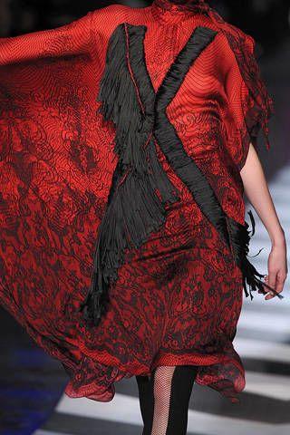 Red, Textile, Carmine, Fashion, Maroon, Costume design, Fashion model, Fashion design, One-piece garment, Haute couture,