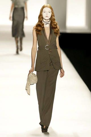 Clothing, Leg, Brown, Sleeve, Fashion show, Shoulder, Standing, Joint, Outerwear, Fashion model,