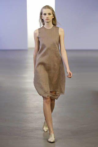 Dress, Human leg, Shoulder, Photograph, Standing, Joint, White, One-piece garment, Style, Formal wear,