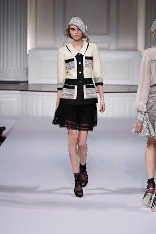 Clothing, Footwear, Leg, Sleeve, Shoulder, Fashion show, Textile, Human leg, Joint, Outerwear,