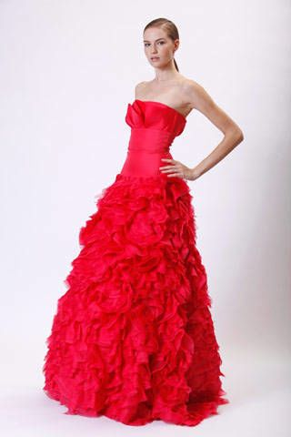 Clothing, Hairstyle, Dress, Shoulder, Textile, Red, Joint, Standing, Formal wear, One-piece garment,