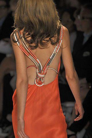 Hairstyle, Shoulder, Style, Fashion, Neck, Jewellery, Fashion model, Blond, Body jewelry, Sleeveless shirt,