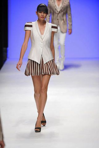 Clothing, Fashion show, Event, Human leg, Shoulder, Runway, Joint, Outerwear, Fashion model, Style,