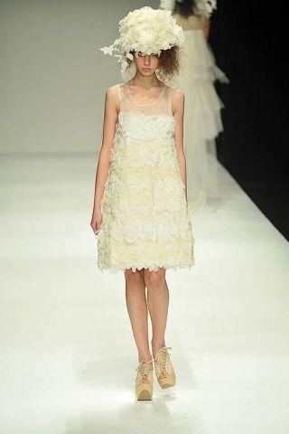 Clothing, Dress, Shoulder, Fashion show, Joint, Runway, Style, Fashion model, Fashion accessory, One-piece garment,