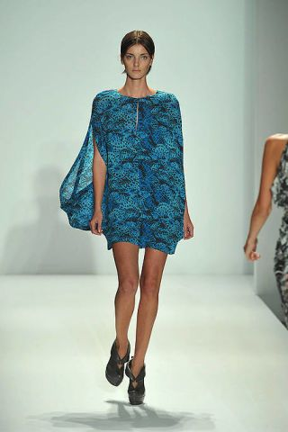 Clothing, Fashion show, Dress, Human body, Human leg, Shoulder, Joint, Standing, One-piece garment, Fashion model,