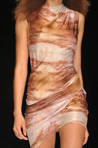 Shoulder, Joint, Human leg, Fashion model, Thigh, Fashion, Neck, Orange, Day dress, Waist,