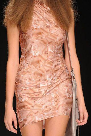 Clothing, Hairstyle, Shoulder, Joint, Human leg, Style, Amber, Orange, Fashion model, Thigh,