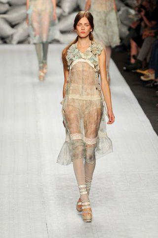 Clothing, Human, Leg, Fashion show, Shoulder, Textile, Joint, Runway, Fashion model, Style,