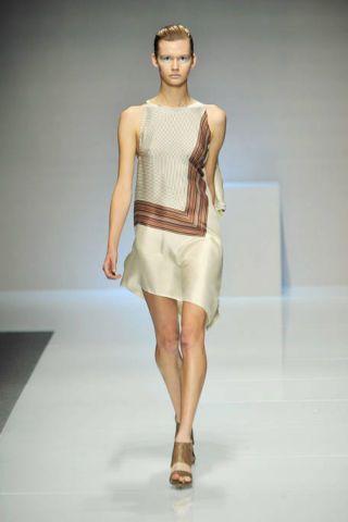 Clothing, Fashion show, Human leg, Shoulder, Runway, Dress, Joint, One-piece garment, Fashion model, Style,