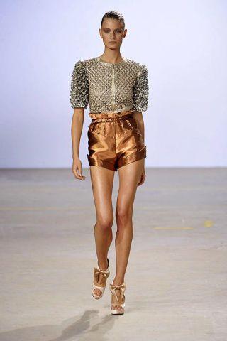 Clothing, Leg, Brown, Skin, Sleeve, Human body, Fashion show, Human leg, Shoulder, Textile,