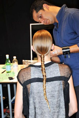 Hair, Hairstyle, Beauty salon, Style, Bottle, Temple, Watch, Hair coloring, Long hair, Drink,