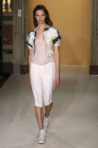 Clothing, Shoulder, Textile, Joint, Human leg, Fashion show, Style, Floor, Waist, Fashion model,