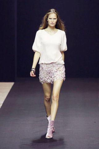 Clothing, Leg, Brown, Sleeve, Human leg, Human body, Shoulder, Textile, Joint, Fashion show,