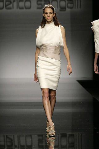 Skin, Dress, Shoulder, Fashion show, Joint, Human leg, Fashion model, Style, Runway, Beauty,
