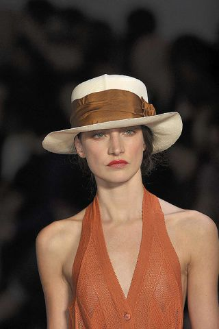 Lip, Mouth, Hat, Hairstyle, Shoulder, Joint, Style, Headgear, Fashion model, Chest,