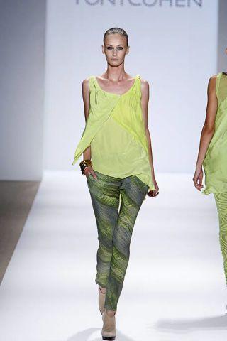 Yellow, Green, Shoulder, Fashion show, Joint, Style, Waist, Fashion model, Runway, Pattern,
