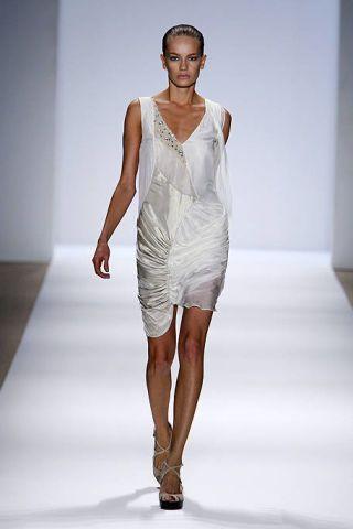 Fashion show, Shoulder, Dress, Runway, Joint, Fashion model, Human leg, Jewellery, One-piece garment, Style,