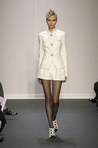 Leg, Sleeve, Fashion show, Shoulder, Human leg, Joint, Collar, Runway, Style, Fashion model,