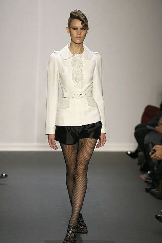 Leg, Sleeve, Human leg, Shoulder, Textile, Joint, Outerwear, Fashion show, Style, Knee,