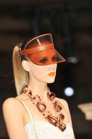 Lip, Headgear, Costume accessory, Temple, Neck, Body jewelry, Toy, Day dress, Earrings, Costume hat,