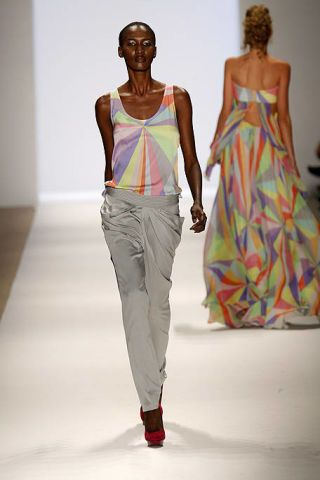 Clothing, Brown, Human body, Shoulder, Textile, Standing, Joint, Fashion show, Waist, White,