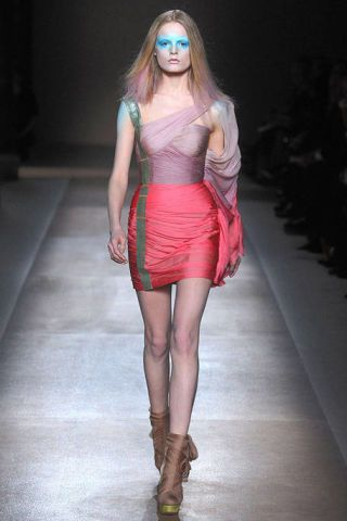 Clothing, Leg, Lip, Human leg, Shoulder, Fashion show, Joint, Fashion model, Runway, Style,