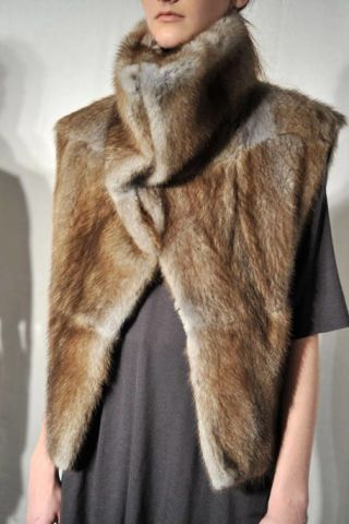 Skin, Sleeve, Textile, Joint, Fur clothing, Fashion, Natural material, Neck, Street fashion, Animal product,